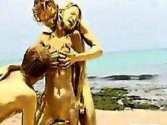 Golden Threesome At The Beach