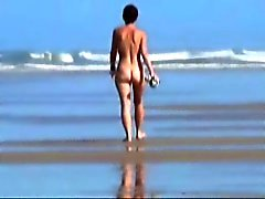 Old girlfriend walking nude on the beach