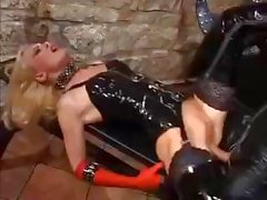 Two hot latex babes take turns sucking and fucking a hard cock