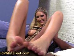 Babe rubs cock with feet