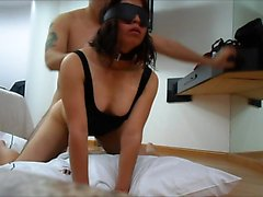 Married couple having a BDSM intercourse