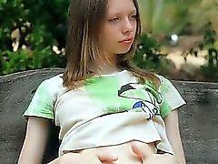 Ultra skinny girl tease on a bench