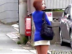 Asian pee chick pisses in public