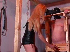 Blonde mistress whipping her slave