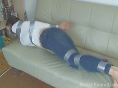 Brunette taped up in jeans