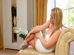 glamorous blonde bride teasing on sofa