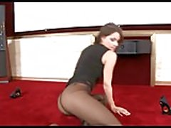 Brunette in black pantyhose tease