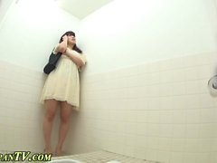 Asian hos pee in toilet