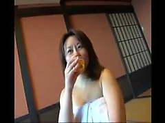 Charming Oriental housewife revealing her lovely body in th
