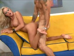 Horny blonde bombshell gives a footjob and gets her bald pussy drilled on the sofa
