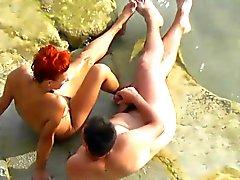 Voyeur. Guy wanking and fuck redhead girl on a public beach