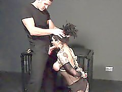 Tied up busty brunette gets blowjob while kneeling