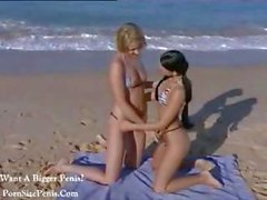 Two hot lesbian beach babes eat some horny pussy on the beach
