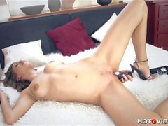 busty brunette has a toy up her wet cunt