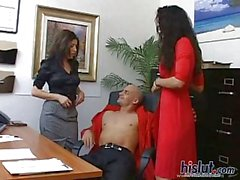 Two sexy babes wanking cock in office