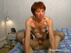 Horny mature redhead slut gets her cock