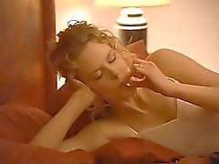 Nicole Kidman standing naked in front of a mirror, her bare