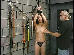 Cute young brunette is restrained and made to cry by older slave master