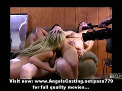 Blonde and brunette girl having an orgy with more men