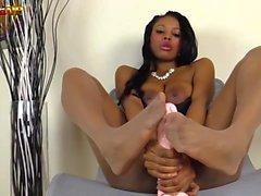 Footjob by Ebony girl in tan pantyhose