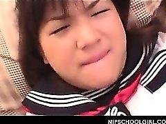 Cute jap doll in school uniform having a taste of horny shaft