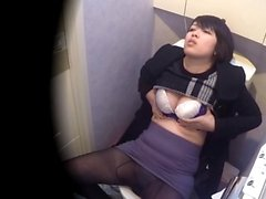 Pissing asian masturbates