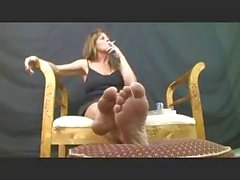 Nasty escort with a phantasmagorical camel hoof smokes one and displays her feet