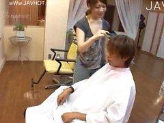 Hot hairdresser at work
