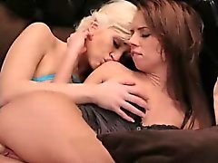Lesbian with strapon fucks brunette in bed
