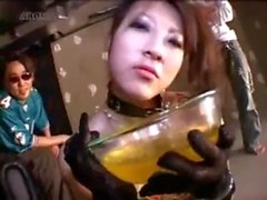 Japanese whore serves as men's urinal at sex party
