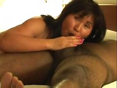 Busty mature Asian wife gets pumped by her hubby's black dick