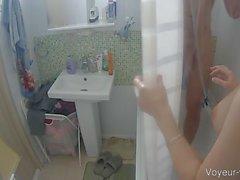Busty dark haired babe shared a shower