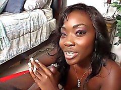 Sexy ebony babe strokes her man's cock while smoking a cigarette