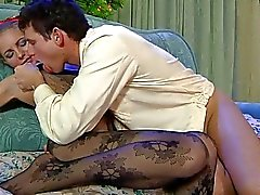 Handsome blonde in black pantyhose does 69 on couch