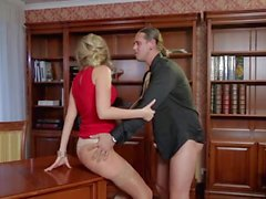 Mature blonde Jenny gets sex on desk