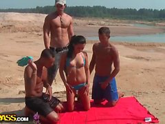Brunette fucked on the beach in all holes