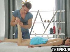 Sexy brunette teen babe getting an oily massage