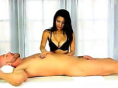 Cute masseuse sucks off clients cock under the massage table