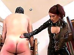 Misstress of torture has a stick