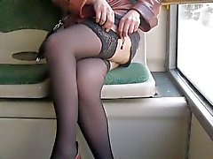 Girl checking her stockings in a bus