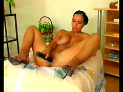 Voluptuous dark-haired Laura Lion uses a dildo to make herself cum