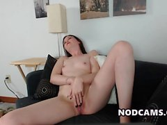 Smal tited chick rubs her shaved pussy