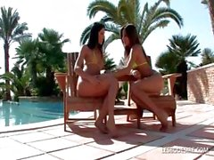 Lesbian bitches have passionate kissing and caressing out by the pool