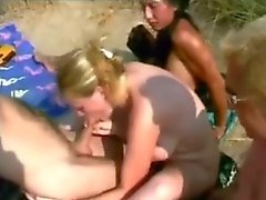 Nude Beach - Blond sucks 3 guys