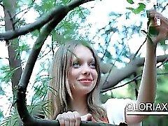 Cute teen Gloria rubbing her pussy outdoor