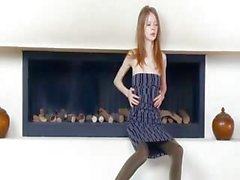 divinely skinny girl by the fireplace