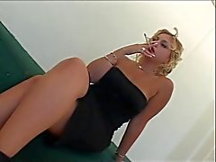 Blond wench smokes before fucking