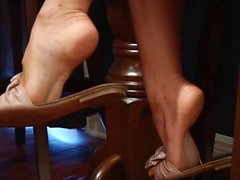 Perfect feet in dangling sandals
