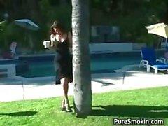 Sexy brunette smoker gets outdoor