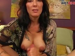 busty milf stepmom gives son a hand